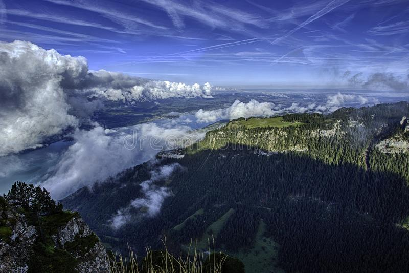 GView of Lake Thun and Bernese Alps including Jungfrau, Eiger and Monch peaks from the top of Niederhorn in summer, Switzerland royalty free stock photos