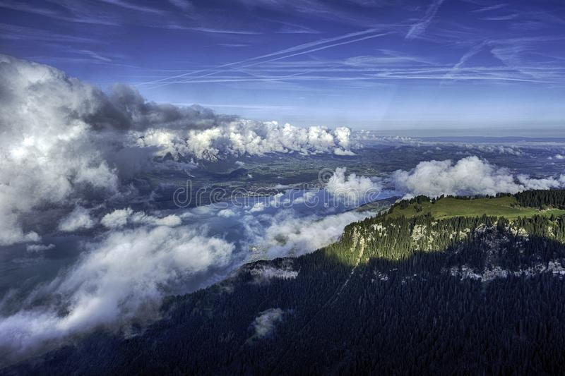 GView of Lake Thun and Bernese Alps including Jungfrau, Eiger and Monch peaks from the top of Niederhorn in summer, Switzerland royalty free stock photography