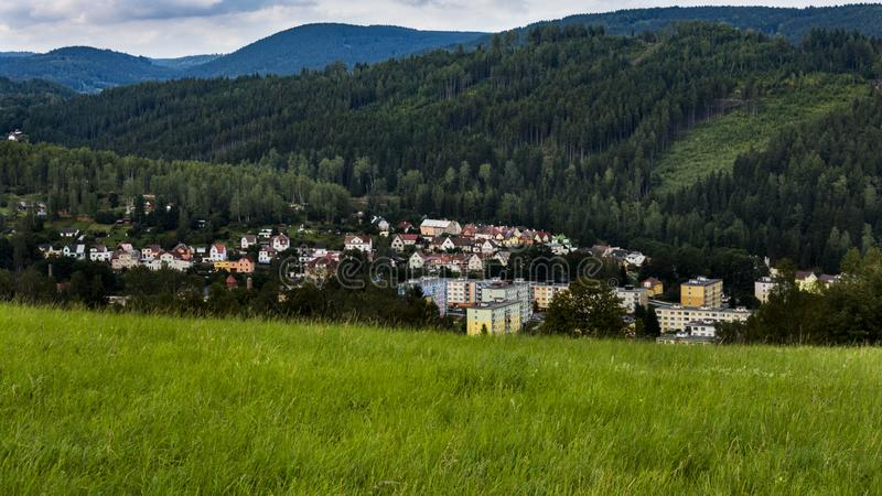 Landscape. View on the landscape with city Kraslice in Krusne hory Czech republic. Hills with forests in the background royalty free stock photo
