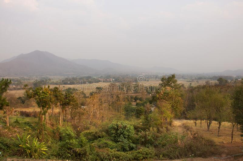 View landscape and cityscape of Pai city with sunrise in morning time while PM 2.5 Dust situation at Pai city hill valley in Mae. Hong Son, Thailand stock images