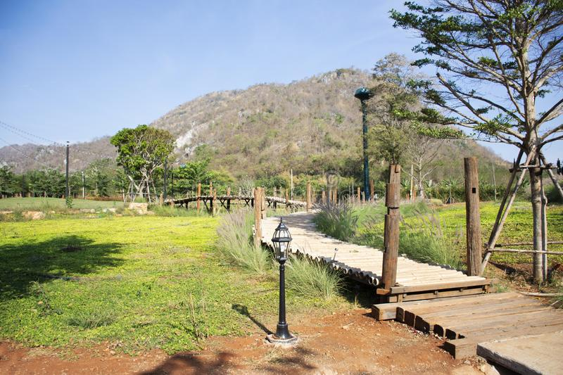 View landscape and mountain with wooden walkway for thai people travel visit and take photo at Nakhon Ratchasima, Thailand. View landscape and mountain with royalty free stock image