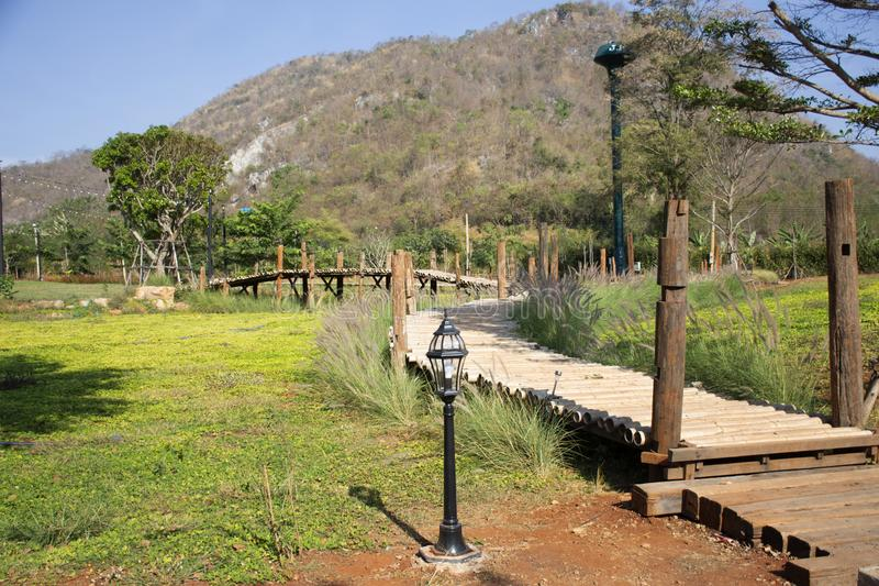 View landscape and mountain with wooden walkway for thai people travel visit and take photo at Nakhon Ratchasima, Thailand. View landscape and mountain with stock photo