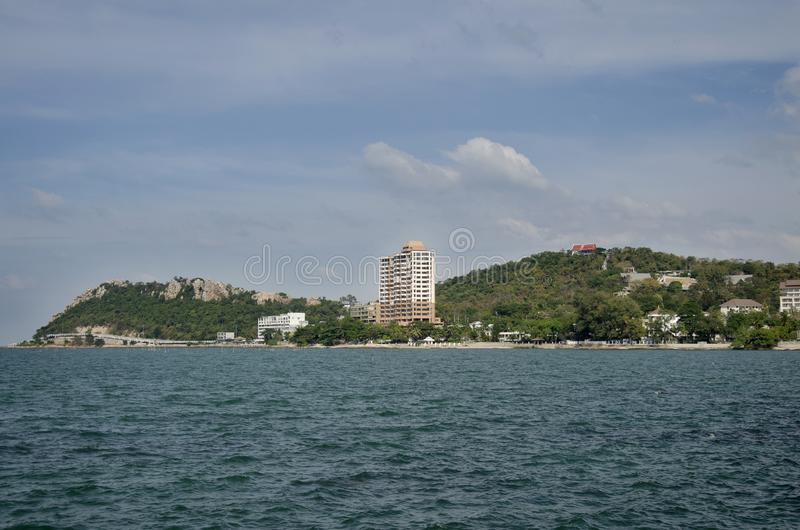 View landscape and seascape of andaman sea at Bangsan beach with view Khao Sam Muk mountain in Chonburi, Thailand. View landscape and seascape of andaman sea at stock images