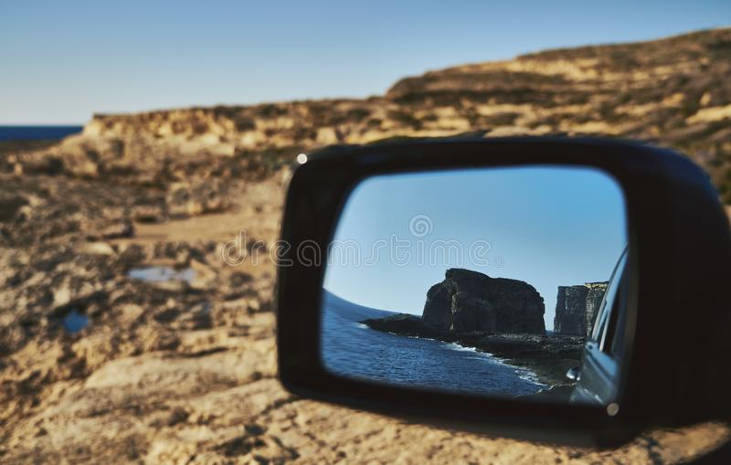 View of the rock from the car mirror stock image