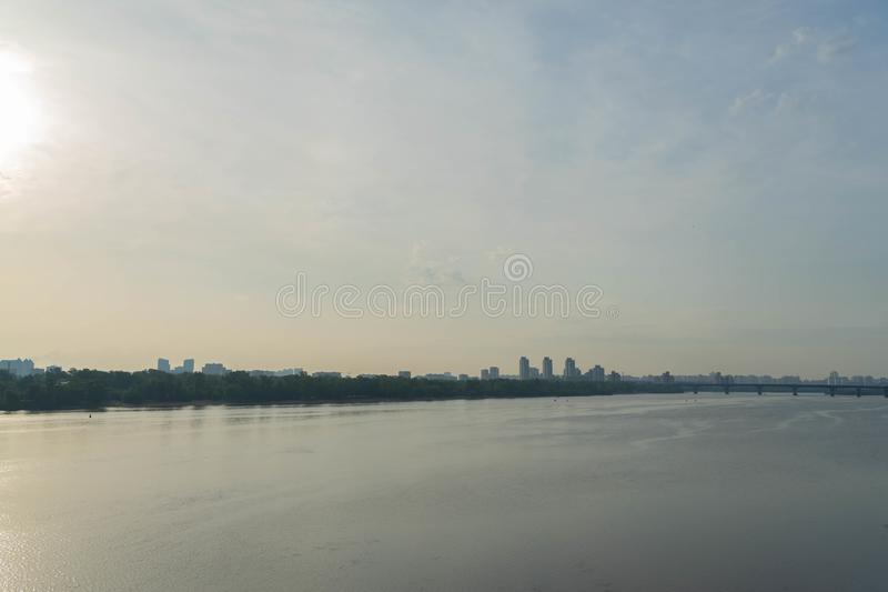 View of a large beautiful city in the early morning. Kiev. Ukraine.View from the Metro Bridge. Car, transportation, summer, outdoors, line, architecture, sky royalty free stock photos