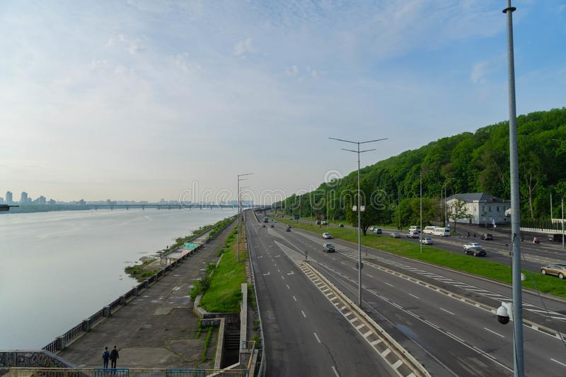 View of a large beautiful city in the early morning. Kiev. Ukraine.View from the Metro Bridge. Car, transportation, summer, outdoors, line, architecture, sky stock photos