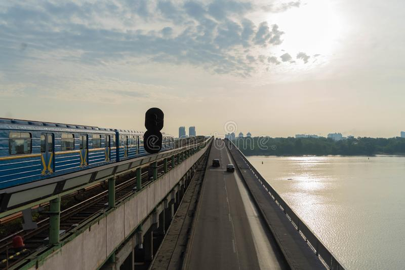 View of a large beautiful city in the early morning. Kiev. Ukraine.View from the Metro Bridge. Car, transportation, summer, outdoors, line, architecture, sky royalty free stock photo