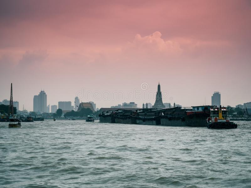View of large cargo ship from side of chao phraya river with old royalty free stock photos