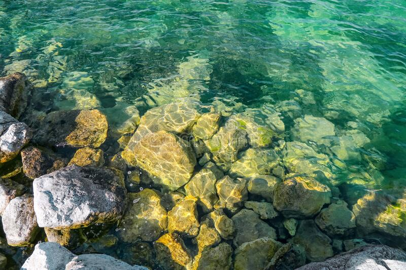 The view of large rocks in Egirdir Lake of Isparta. Transparent lake water. Egirdir is a visitable place for holiday lovers all year round. Turkey stock photo