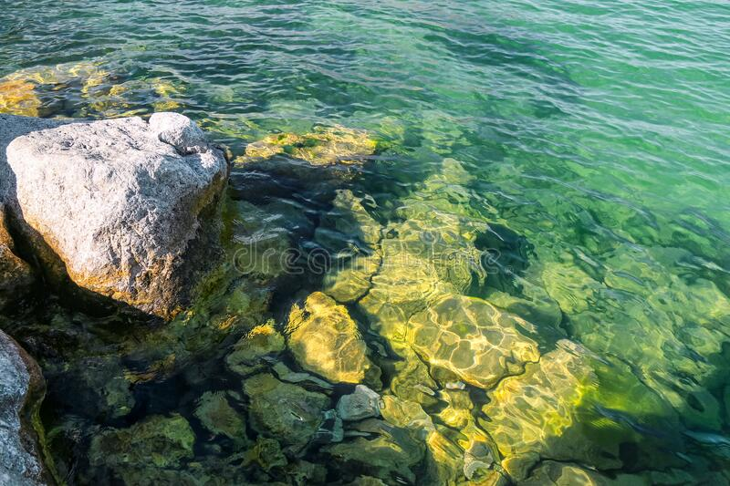 The view of large rocks in Egirdir Lake of Isparta. The beautiful transparent lake water. Egirdir is a visitable place for holiday lovers all year round royalty free stock photography