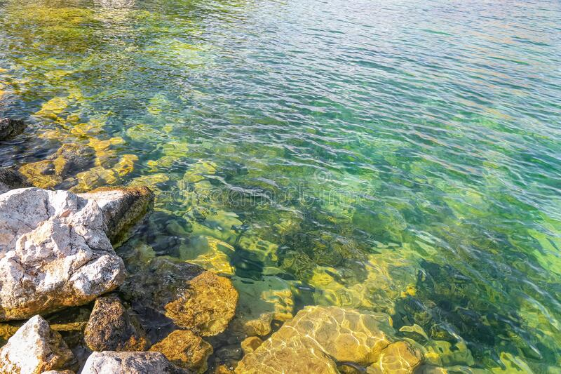 The view of large rocks in Egirdir Lake of Isparta. Transparent lake water. Egirdir is a visitable place for holiday lovers all year round. Turkey royalty free stock image