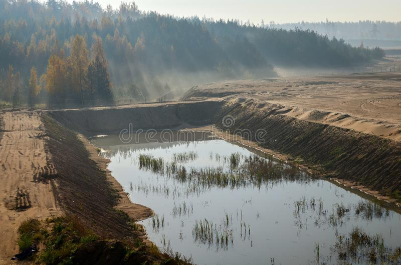 View of the large sand pit. Production useful minerals. stock photos