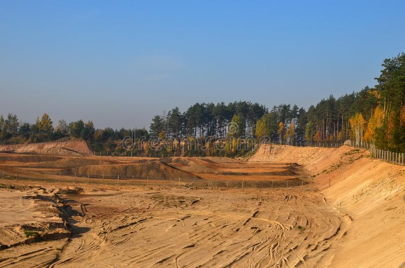 View of the large sand pit. Production useful minerals. royalty free stock image