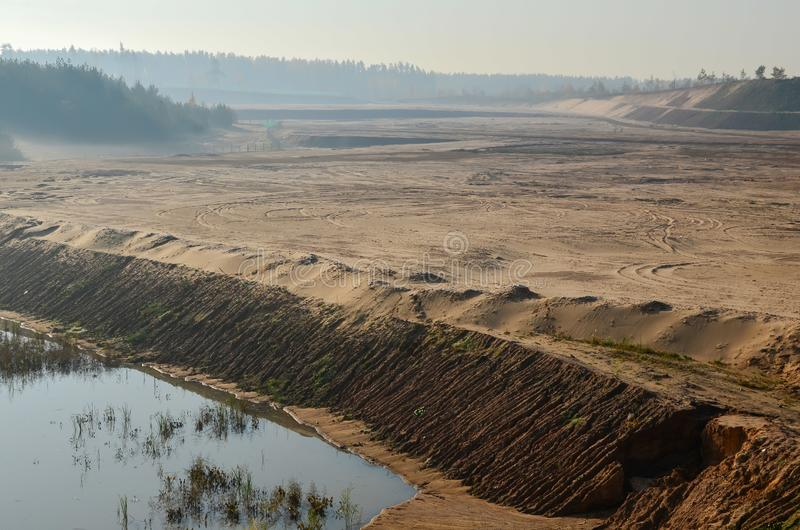 View of the large sand pit. Production useful minerals. royalty free stock photography