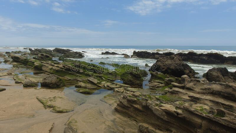 View of the Las Pocitas sector on the beach of Mancora on a cloudy day stock photo