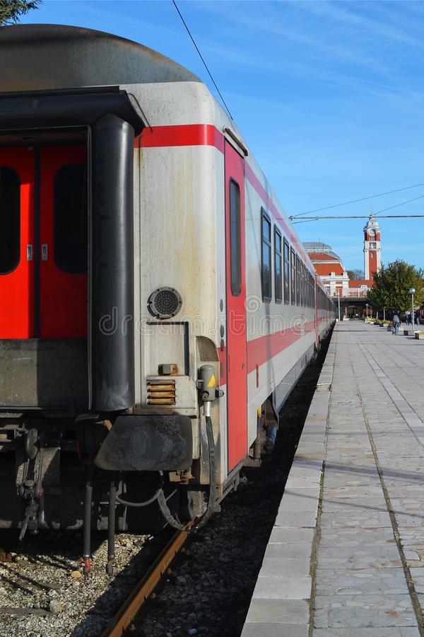 View from the last white passenger train car to the railway station during the day stock photos