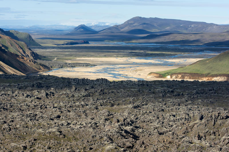View of lava field, valley and river in a distance in Landmannalaugar, Iceland royalty free stock photos