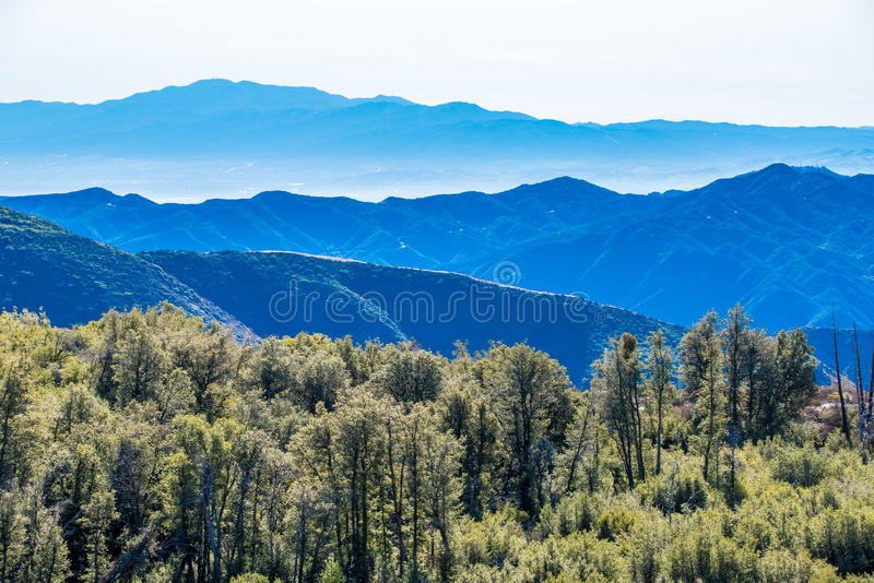 View of layers of nature mountains and nature trees. stock photo