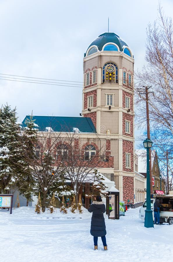 View of Le Tao Clock Tower in Otaru, Hokkaido, Japan on a bright. Otaru, Hokkaido, Japan - 30 December 2017 - Tao Clock Tower stands tall and gets ready to chime stock image