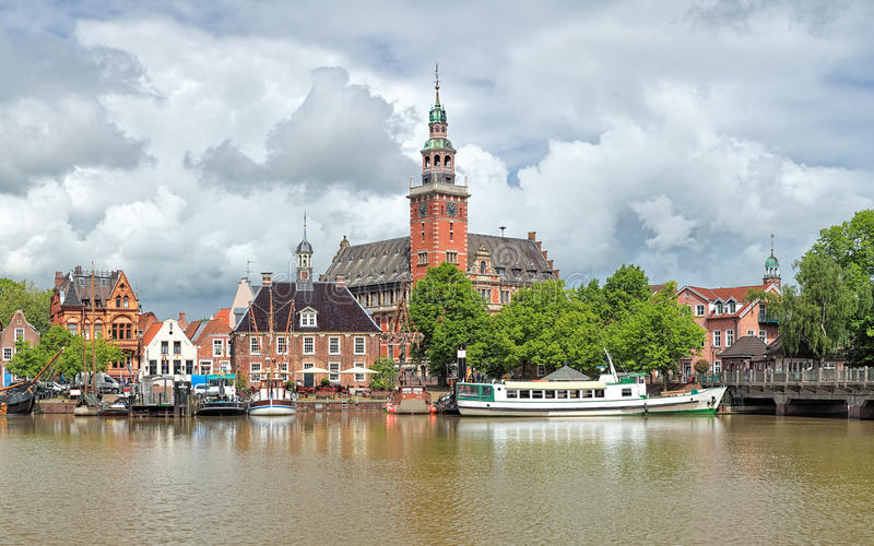 View from Leda river on City Hall and Old Weigh House in Leer, Germany. Leer, Germany. View from Leda river on the City Hall in Dutch Renaissance style, the Old royalty free stock photo