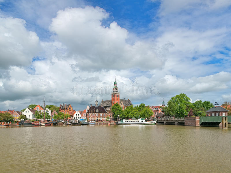 View from Leda river on City Hall and Old Weigh House in Leer, Germany. Leer, Germany. View from Leda river on City Hall in Dutch Renaissance style, Old Weigh stock images