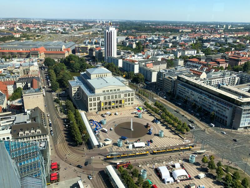 The view of Leipzig with the famous opera, the Augustusplatz and in the background the main station with blue sky stock photo
