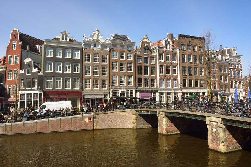 View of Leliegracht bridge spanning Prinsengracht canal in Amsterdam. Amsterdam, The Netherlands – April 1, 2016. View of Leliegracht bridge spanning royalty free stock image