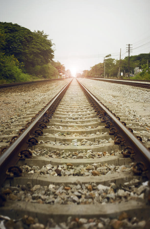 View of the length of railway with green tree at left and right side of railway,filtered image, light effect and flare added royalty free stock images