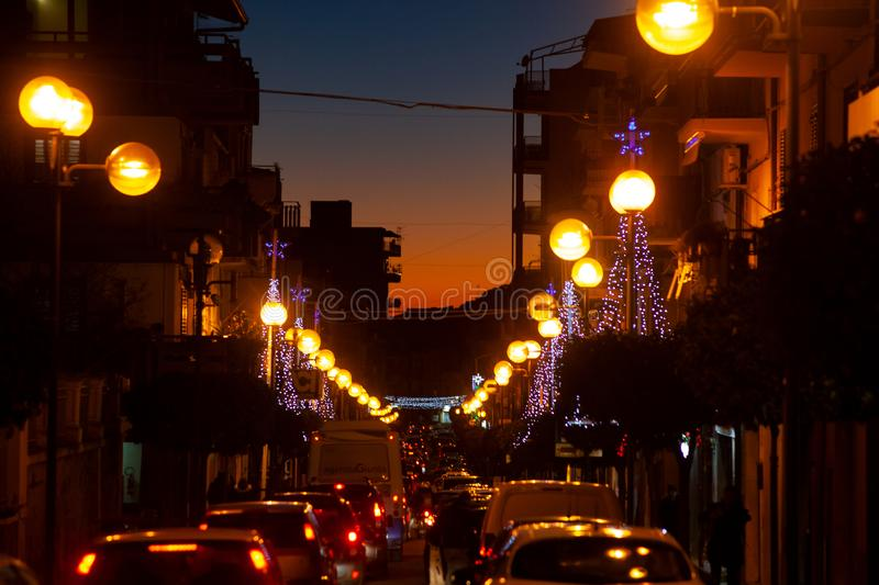 View of Leonforte street at sunset. LEONFORTE, ITALY - DECEMBER, 27: View of Leonforte street at sunset on December 27, 2018 royalty free stock photography