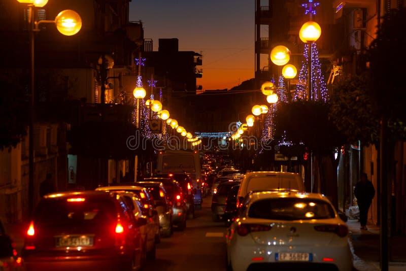 View of Leonforte street at sunset. LEONFORTE, ITALY - DECEMBER, 27: View of Leonforte street at sunset on December 27, 2018 stock images