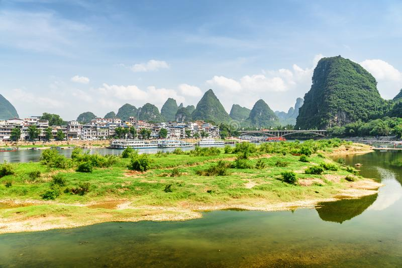 View of the Li River (Lijiang River) and Yangshuo Town. Among beautiful karst mountains on summer sunny day. Landscape at Yangshuo County of Guilin, China royalty free stock image