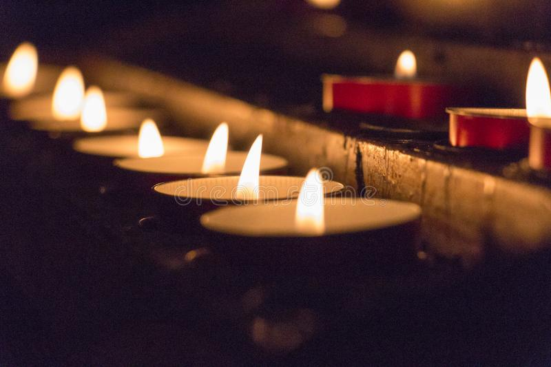 The view of lighted tealight candles. Burning candles. Close up view of lighted tealight candles royalty free stock photos
