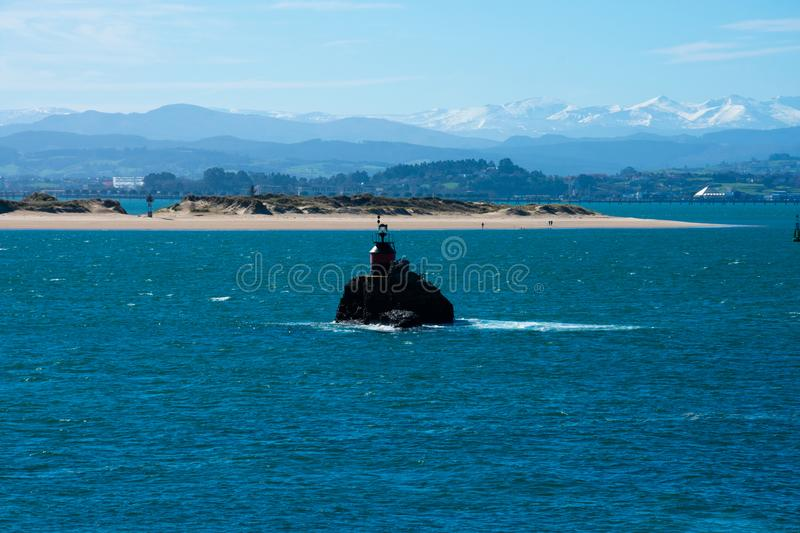 View of a lighthouse on Cantabrian Sea Islote la Horadada royalty free stock image