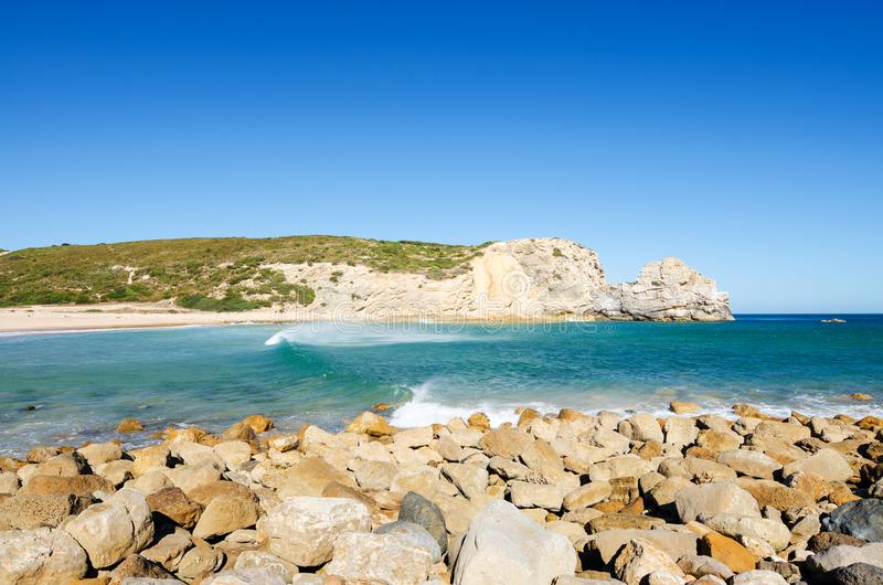 View of the limestone cliffs and Atlantic ocean. Ravine Beach Praia do Barranco - wild beach and popular surfing spot in Algarve. Sagres Vila do Bispo, Faro stock photo
