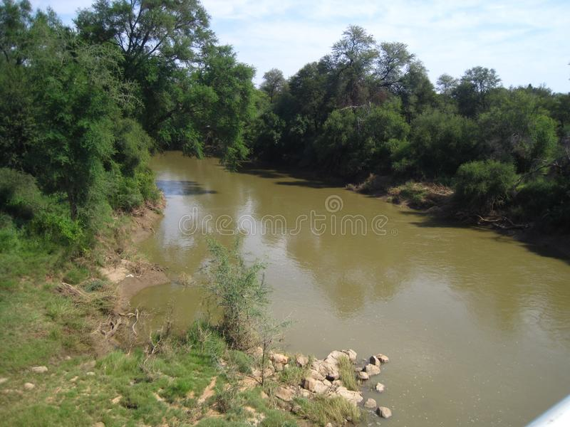 LIMPOPO RIVER AT STOCKPOORT BORDER POST. View of the Limpopo river at the Northern border between South Africa and Botswana stock images