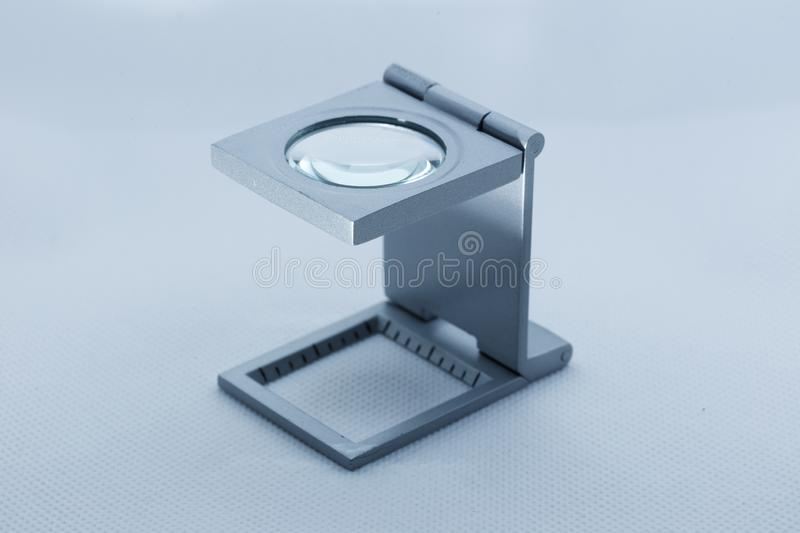 View of a linen tester magnifying glass used by philatelist hobbyst stock photo