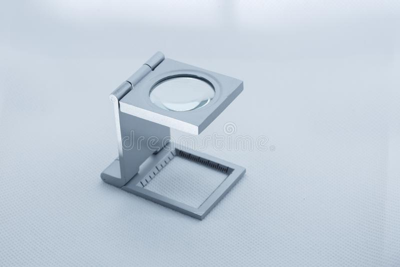 View of a linen tester magnifying glass used by philatelist hobbyst royalty free stock images