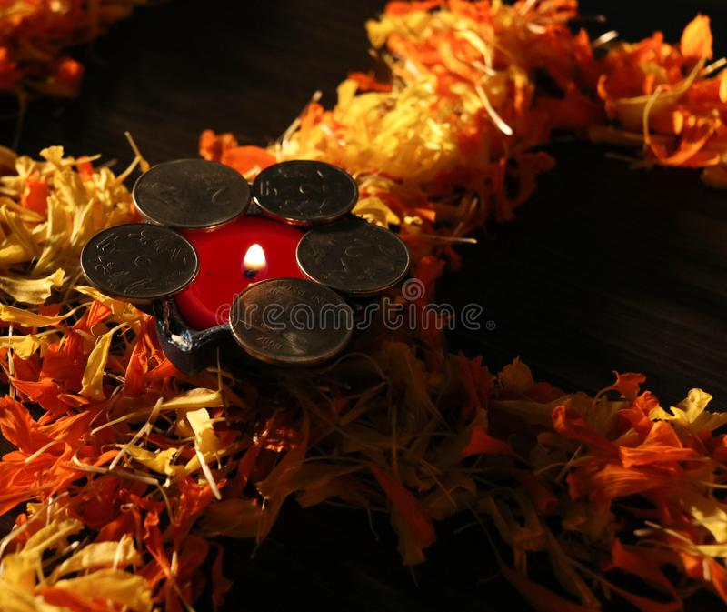 Dhanteras and diwali background.diwali greetings and wishes. A view of lit Diya placed on swastik for celebrating diwali and dhanteras festival royalty free stock photography