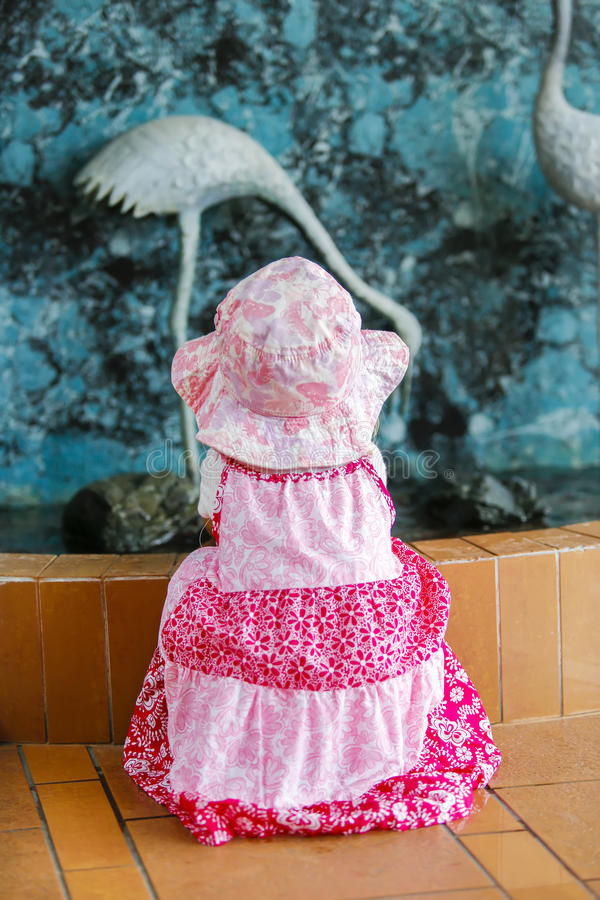 View of little girl in nice pink dress and a hat stock photos