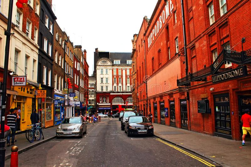 Little Newport street Chinatown London United Kingdom. View of Little Newport street lined with chinese restaurants and shops in Chinatown area,Hippodrome casino royalty free stock photography