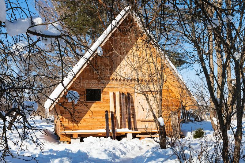 View of little timber chalet and wide skis royalty free stock photography