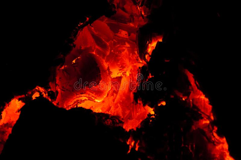 View on live hot burning coals of firewood in fireplace royalty free stock images