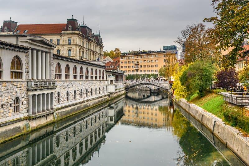 View of Ljubljanica river and Triple Bridge or Tromostovje. Ljubljana. Slovenia royalty free stock photo