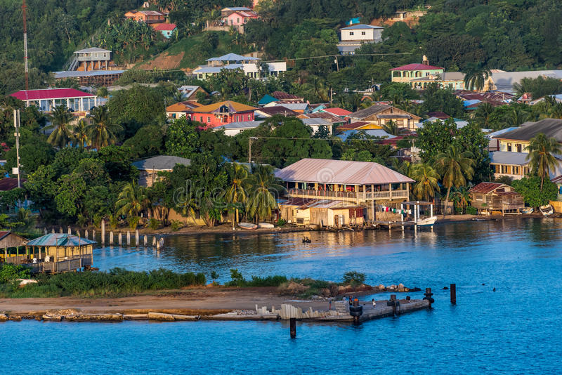 View of Local Island Village from the Cruise Ship. At sunset royalty free stock photos