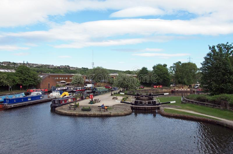 a view of the lock entrance to brighouse basin and moorings on the calder and hebble navigation canal in calderdale west yorkshire royalty free stock photos