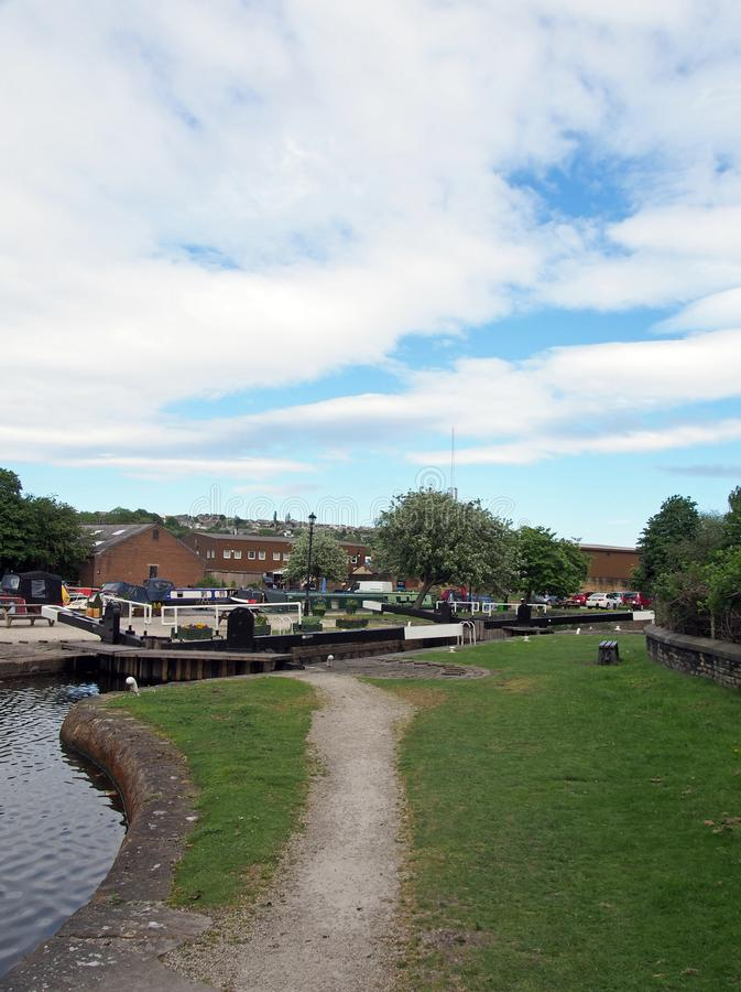 A view of the lock entrance to brighouse basin and moorings on the calder and hebble navigation canal in calderdale west yorkshire. Brighouse, west yorkshire stock images