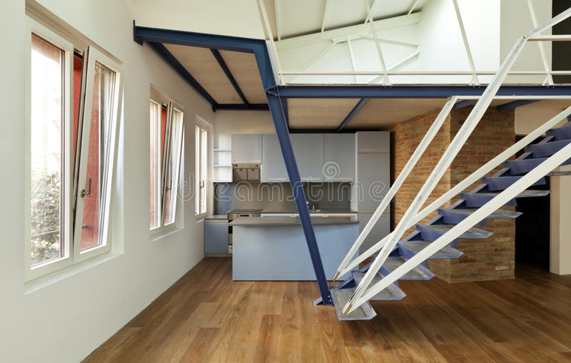 View of the loft. Modern designer, apartment with mezzanine royalty free stock image