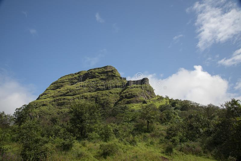 View of Lohagad fort from Lahagadwadi Village near Lonavala,Maharashtra,India. Asia royalty free stock photo