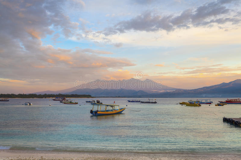 View of Lombok from Gili T. Sunset on Gili Trawangan Island in Indonesia stock photography