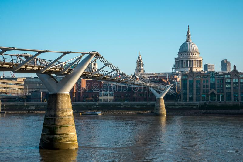 A view of London Millenium Bridge and St Paul`s Cathedral from Bankside in South Bank of Thames River stock images